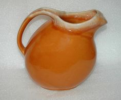 "Hull USA Oven Proof Pumpkin Orange Drip Glaze Pitcher with ice lip  Vintage.    It is 7"" tall to the spout.  Then 7"" from spout to handle.   	The condition is very good.  There is line or crack on..."