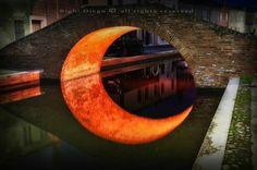 Accidental moon under a bridge