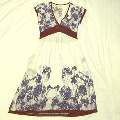 Vintage-style Anthropologie Prairie Dress This gorgeous vintage-style prairie dress by Lucca for Anthropologie has been a staple in my closet for several years but it just doesn't fit anymore :( it's been with several times but it has so much more life in it. Fabric is 100% cotton and it is SO soft. Lined but still see-through so a good slip or spanks works well underneath. Colors are cream, brown, and flowers are faded royal blue. Also has pockets! Anthropologie Dresses