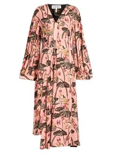 There's a distinct bohemian feel to Loewe's light-pink asymmetric midi dress. It's part of a capsule collection designed in collaboration with legendary Ibizan boutique, Paula's, and is patterned with an archival design of tonal-pink, green, and cream waterlilies. Raw-edge seams lend the fluid silhouette an artisanal vibe, while it turns to reveal uneven brown cotton panels on the reverse. Style it as part of a striking day look with leather slides.