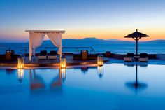 Sunset pool in Santorini, Greece..