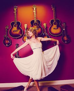 guitars!    (I actually have one exactly like the one directly behind her head.)