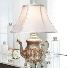 Teapot Lamp, love to see this. But I don't want him at my house.