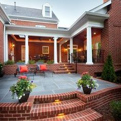 brick porch with flagstone, white columns