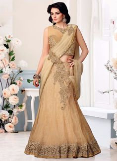 http://www.sareesaga.in/index.php?route=product/product&product_id=28079 Style:Lehenga Saree Shipping Time:10 to 12 Days Occasion:Party Wedding Fabric:Net Colour:Beige Work:Embroidered Patch Border Work For Inquiry Or Any Query Related To Product, Contact :- +91-9825192886, +91-7405449283
