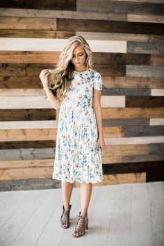 Cute floral dress. Like the pleated skirt to give the dress a little something extra.