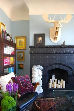 Don't Be Afraid of the Dark: 12 Black Walls Done Right : I love the black fireplace, but the hands creep me out Painted Brick Fireplaces, Paint Fireplace, Black Fireplace, Fireplace Ideas, 1930s Fireplace, Fireplace Candles, Fake Fireplace, Fireplace Design, New Living Room