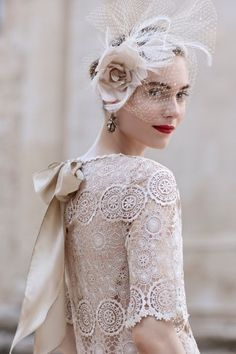 A lace wedding dress looks perfect with a birdcage veil and red lips!