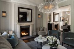 Knightsbridge Residence by Staffan Tollgard Design Group! Luxury Living Room Contemporary Armchairs Moder Lighting Design #bestukinteriordesigners #interiordesignlondon #Staffantollgardprojects Find more inspirations in: http://www.brabbu.com/en/inspiration-and-ideas/
