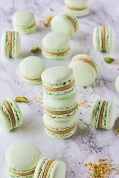 Sweet and chewy macarons, the most decadent of french desserts, filled with rich Pistachio White Chocolate ganache. White Chocolate Ganache, Chocolate Cream, Pistachio Recipes, Macaron Recipe, French Desserts, Sandwich Cookies, Food Hacks, Food Photography, Fimo