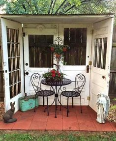 FIVE OLD DOORS CREATE THIS BEAUTIFUL NOOK IN YOUR YARD!  such a cute idea...