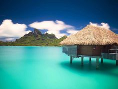 Dreaming of a vacation in Bora Bora? The Four Seasons Resort is considered paradise. Amazing views and luxurious overwater bungalows | boraboraphotos.com