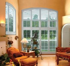Sunburst shutters - they do make them for the upper curved windows as well.