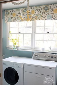 Bright & Cheery Laundry Room - A small laundry room got a cheery makeover with paint, fabric, a new light fixture and organized storage...