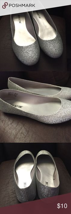 Silver flats Silver flats work to my first homecoming and only worn that night. Lower East Side Shoes Flats & Loafers