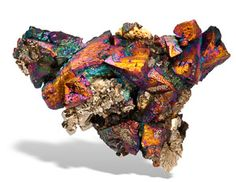 Chalcopyrite is unusual from Washington State and this single example is among the finest Chalco s I know of from any where in the world. The large colorful Chalco crystals are all sharp and have such an array of colors it would be impossible to say which one dominates, and they actually change as you rotate the piece.