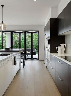 Arden Homes Kitchen featuring Calacatta Nuvo surfaces with black accents and a black tap External Bifold Doors, Home Design Decor, House Design, Arden Homes, Weatherboard House, Kitchen Benchtops, Black Doors, Home Kitchens, Modern Kitchens