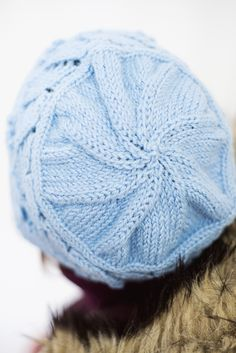 Lace and bobbles blend together to create this one-of-a-kind hat. Keep your head warm while donning this eye-catching design featured in baby blue yarn.