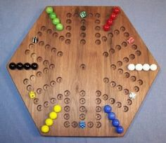 Wahoo/Aggravation is a cross and circle board game for 4 to 6 players, similar to Parchisi. It involves moving a set number of marbles around the board, trying to get them into the safety zone. The game originated in the Appalachian hills and has been popular for decades.