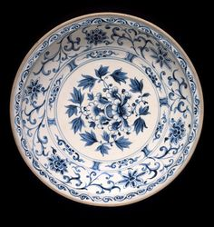 Large Dish with Peony Spray, Floral Scrolls, and Lotus Petals, Vietnam, circa 1400-1600. Wheel-thrown stoneware with cream slip, underglaze blue painted decoration, and clear glaze, 3 x 14 1/4 in. (7.62 x 36.2 cm). Los Angeles County Museum of Art, Gift of Mr. and Mrs. Harry Lenart (M.74.32.1). Photo © Museum Associates/LACMA