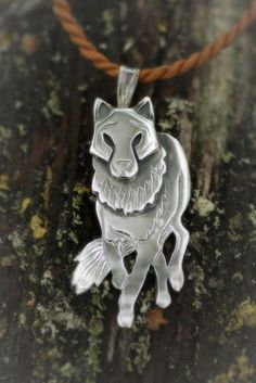 Necklace | Paarma Design       Wolf - Trailblazer who takes care of the Loved Ones Symbol of adaptability and stamina. Metal Stamping, First Love, Wolf, Lion Sculpture, Symbols, Statue, Chain, Animals, Jewelry