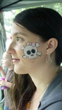 Special Request: Cutesy Skull cheek art for my Sister.