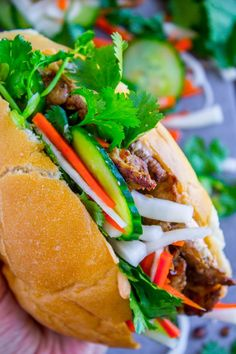 Banh Mi Sandwich from The Food Charlatan. These traditional Vietnamese Banh Mi Sandwiches will blow your mind! A mini soft baguette, smeared with sriracha mayo, topped with thinly sliced marinated pork, pickled veggies, and tons of cilantro. Healthy Sandwiches, Sandwich Recipes, Pork Recipes, Asian Recipes, Cooking Recipes, Sandwich Fillings, Wrap Recipes, Vietnamese Sandwich, Banh Mi Sandwich