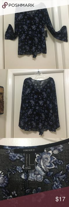 Forever 21 Black Floral Top Forever 21 Black Floral Button Down Tunic; blue, white and black flowers; arms flare at end; new with tags. Forever 21 Tops Tunics