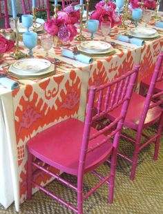 belle maison: Trending: Ikat Prints--i like how these table runners are laid on the table