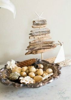 Mini driftwood tree with starfish topper: http://www.completely-coastal.com/2015/12/coastal-country-christmas-home-tour.html