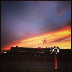 Sunset over Bristol Motor Speedway Motor Speedway & Dragway Bristol Motor Speedway, Nascar, Cowboy Boots, Roots, Northern Lights, This Is Us, Social Media, Smoke, Sunset