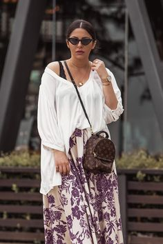 5 Tips To Rock The Oversized Look by Stella Asteria - Wearing oversized short, asymmetrical skirt, Louis Vuitton Palm Springs backpack, Chanel slingbacks and cat-eye sunglasses - Spring Style Inspiration
