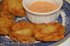 Deep South Dish: Fried Green Tomatoes II - Fried green tomatoes dipped in milk, then dredged in a combination of flour, cornmeal and crumbled saltine crackers, then pan fried. I Love Food, Good Food, Yummy Food, Yummy Recipes, Free Recipes, Tasty Snacks, Party Recipes, Yummy Eats, Yummy Drinks
