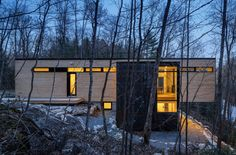 Cantilevered timber-clad retreat overlooks lakeside views in Canada!