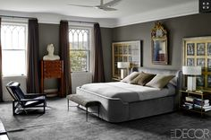 Bravo!  A masculine, somber room with a little gilt…love!