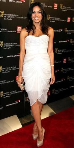 Who made Rosario Dawson's clutch, white strapless dress and nude pumps that she wore to the BAFTA red carpet? Shoes – Brian Atwood  Purse – Jimmy Choo  Dress – Christian Siriano Spring 2011 collection