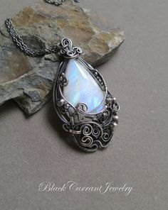 https://www.etsy.com/listing/494812178/rainbow-moonstone-and-dark-sterling?ref=shop_home_active_6