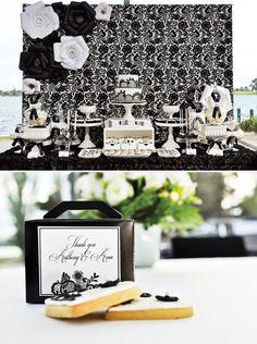 Mesa de postres blanco y negro.