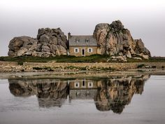 "The famous and beautiful ""house between the rocks"" located in France, along La Cote de Granit Rose in Brittany near Plougrescant."
