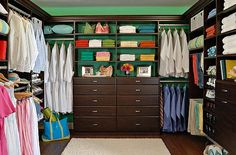 I like this layout for master walk in closet just don't need to be so big. drawers and shoe racks in center and his hanging stuff on the left and mine on the right