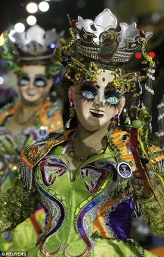 Members of the Diablada Urus group perform during the Carnival parade in Oruro, right...
