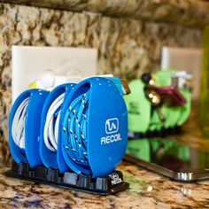 Ban cord clutter from the kitchen! Recoil Winders will clean up the cords in your kitchen or charging station in no time. Available in 5 colors.