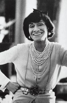 Coco CHANEL wearing her famous multi strands of pearls