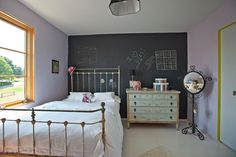 Child's bedroom furnished with vintage pieces. Photo: Tony Cenicola/The new York Times