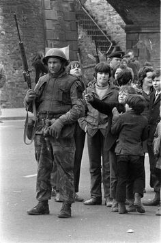 Local children taunt and play with a British soldier as he stands guard in Londonderry, Northern Ireland, April 13, 1972, following an explosion in the city. (AP Photo/Michel Lipchitz) Ref #: PA.8671020