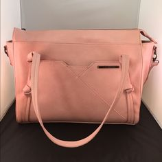 SOLDSteve Madden Tote Brand new soft pink Steve Madden tote. Comes with a removable shoulder strap that is also adjustable. Very cute chevron stripes interior with pink highlights. New with tag Steve Madden Bags Totes