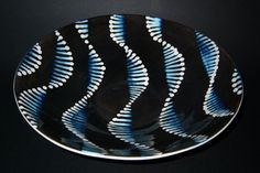 John Newdigate Ceramics:   At night, microscopic sea-creatures put on a dazzling light-show. This is my interpretation of what I have seen.