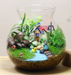 Terrarium with blue stones for water and figurines
