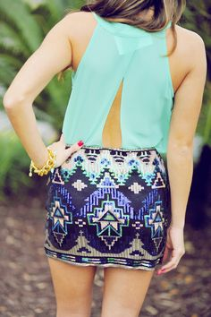 Mint sheer top with a cutout in the back and a blue and beige and a little mint green tribal skirt