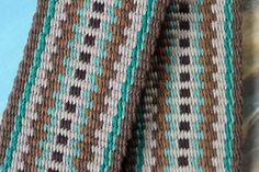 In the normal weaving process on an inkle loom, the patterns are formed simply by the way the colors are arranged on the loom. As I raise and lower the threads, the pattern forms naturally, repeating every other row.